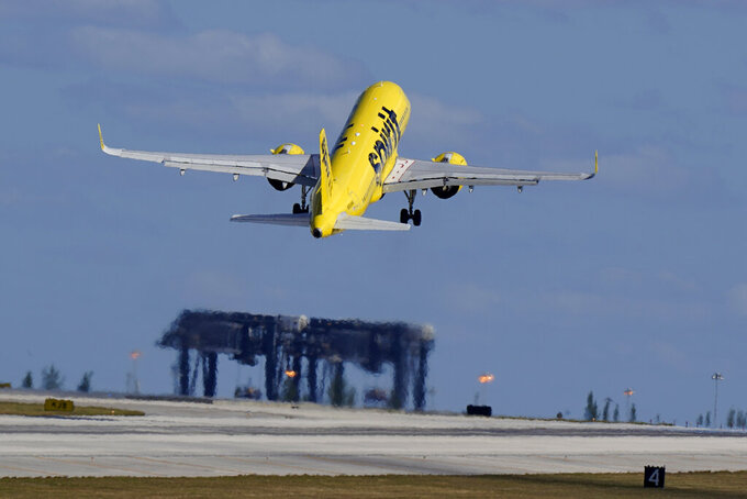FILE - In this Jan. 19, 2021 file photo, a Spirit Airlines Airbus A320 takes off from Fort Lauderdale-Hollywood International Airport in Fort Lauderdale, Fla.  The budget airline will get a chance to add flights at the busy airport in Newark, New Jersey, just outside New York City. The Transportation Department said Thursday that it will give coveted afternoon and evening runway rights to a low-cost airline.   (AP Photo/Wilfredo Lee)