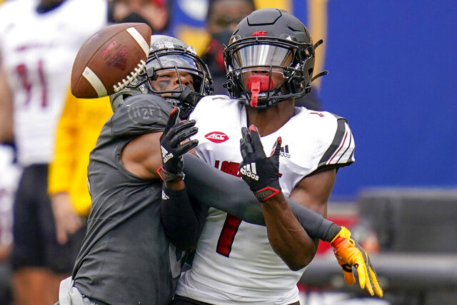Louisville wide receiver Tutu Atwell (1) can't make a catch as Pittsburgh defensive back A.J. Woods (25) is called for pass interference during the second half of an NCAA college football game, Saturday, Sept. 26, 2020, in Pittsburgh. Pittsburgh won 23-20.(AP Photo/Keith Srakocic)
