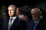 FILE - In this file photo taken on Oct. 29, 2009, Israeli Prime Minister Benjamin Netanyahu, left, and Israeli President Shimon Peres, right, attend a memorial ceremony marking the 14th anniversary of the assassination of Israeli Prime Minister Yitzhak Rabin, at Mt. Herzl cemetery in Jerusalem. Rabin was shot and killed by right-wing Jewish activist Yigal Amir on November 4, 1995. (AP Photo/Uriel Sinai, Pool)