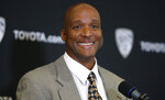 Karl Dorrell smiles during a news conference to announce that he is the new NCAA college head football coach at Colorado during a news conference Monday, Feb. 24, 2020, in Boulder, Colo. (AP Photo/David Zalubowski)