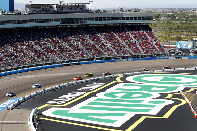 Cars race through Turn 3 during the NASCAR Cup Series auto race at ISM Raceway, Sunday, March 10, 2019, in Avondale, Ariz. (AP Photo/Ralph Freso)