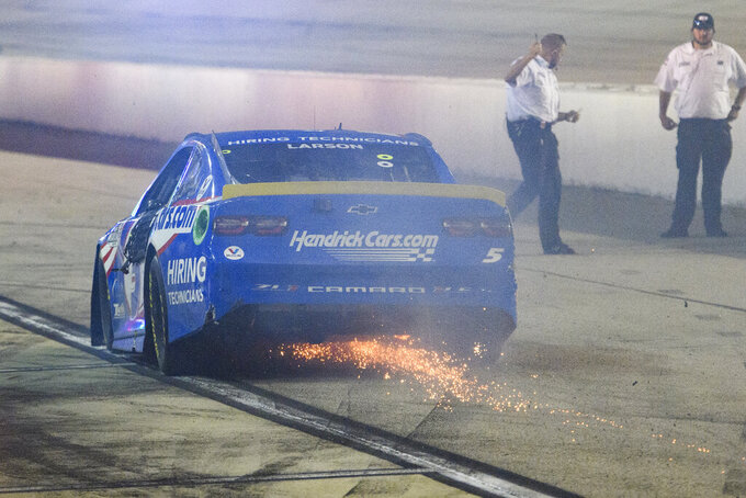 Kyle Larson pulls in to the pit area after finishing a NASCAR Cup Series auto race Sunday, Sept. 5, 2021, in Darlington, S.C. (AP Photo/John Amis)