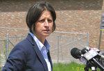 Vermont U.S. Attorney Christina Nolan speaks at a news conference on Wednesday, May 22, 2019 in Newport, Vt., about four men who were indicted in Burlington a multi-million dollar fraud case. She spoke next to a vacant block in downtown Newport where a building was purchased with money from what turned out to be the fraudulent activity, and was torn down. (AP Photo/Wilson Ring)