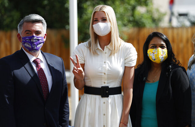 Presidential advisor Ivanka Trump, center flashes a victory sign while being photographed with U.S. Sen. Cory Gardner, R-Colo., left, and Archie Shinde, owner of a Bright Beginnings Learning Center, after a roundtable discussion on child care early Friday, July 24, 2020, in Greenwood Village, Colo. (AP Photo/David Zalubowski)