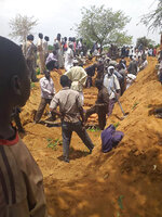 Residents dig a mass grave for victims of an attack that left over 60 dead in the village of Masteri in west Darfur, Sudan Monday, July 27, 2020. A recent surge of violence in Darfur, the war-scarred region of western Sudan, has deprived more than 14,000 children of medical care, a leading aid group reported on Thursday, July 30, 2020. (Mustafa Younes via AP)