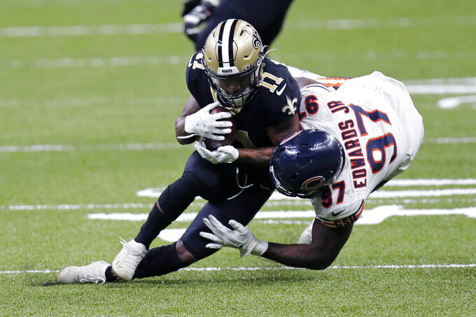 New Orleans Saints wide receiver Deonte Harris (11) is brought down by Chicago Bears defensive end Mario Edwards (97) in the first half of an NFL wild-card playoff football game in New Orleans, Sunday, Jan. 10, 2021. (AP Photo/Brett Duke)