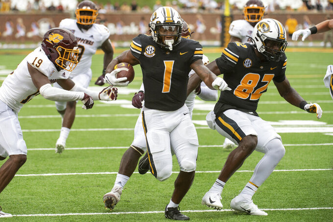 Missouri running back Tyler Badie, center, scores a touchdown past Central Michigan's Donte Kent, left, during the first half of an NCAA college football game Saturday, Sept. 4, 2021, in Columbia, Mo. (AP Photo/L.G. Patterson)