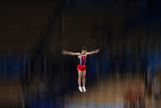 Ivan Litvinovich, of Belarus, competes in the men's trampoline gymnastics final at the 2020 Summer Olympics, Saturday, July 31, 2021, in Tokyo. (AP Photo/Ashley Landis)