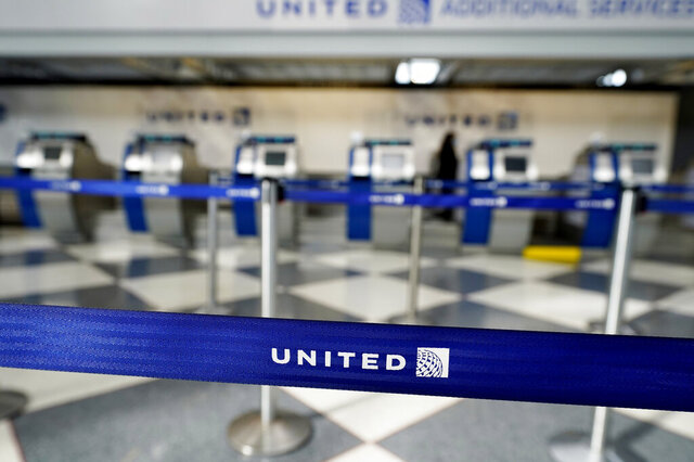 Empty ticketing counters are seen in Terminal 1 at O'Hare International Airport in Chicago, Wednesday, Oct. 14, 2020. United Airlines, which furloughed 13,000 employees this month, is expected to report a large third-quarter loss as the coronavirus pandemic continues to batter air travel. (AP Photo/Nam Y. Huh)