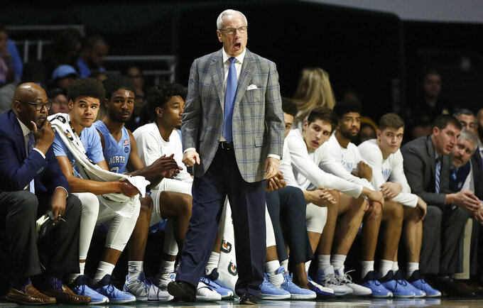 North Carolina head coach Roy Williams yells towards his players during the first half of an NCAA college basketball game against the Miami on Saturday, Jan. 19, 2019, in Coral Gables, Fla. (AP Photo/Brynn Anderson)