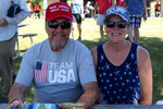 """Lynda Thibado and Don Briggs, of Menomonie, Wis., were among supporters of former President Donald Trump who attended a rally organized by pillow salesman-turned conspiracy peddler Mike Lindell in New Richmond, Wis., on Saturday, June 12, 2021. """"It's so nice to be around other people that feel the same way you feel,"""" said Briggs. For a few hours last weekend, thousands of Donald Trump's loyal supporters came together under the blazing sun in a field in western Wisconsin to live in an alternate reality where the former president was still in office — or would soon return. (AP Photo/Jill Colvin)"""