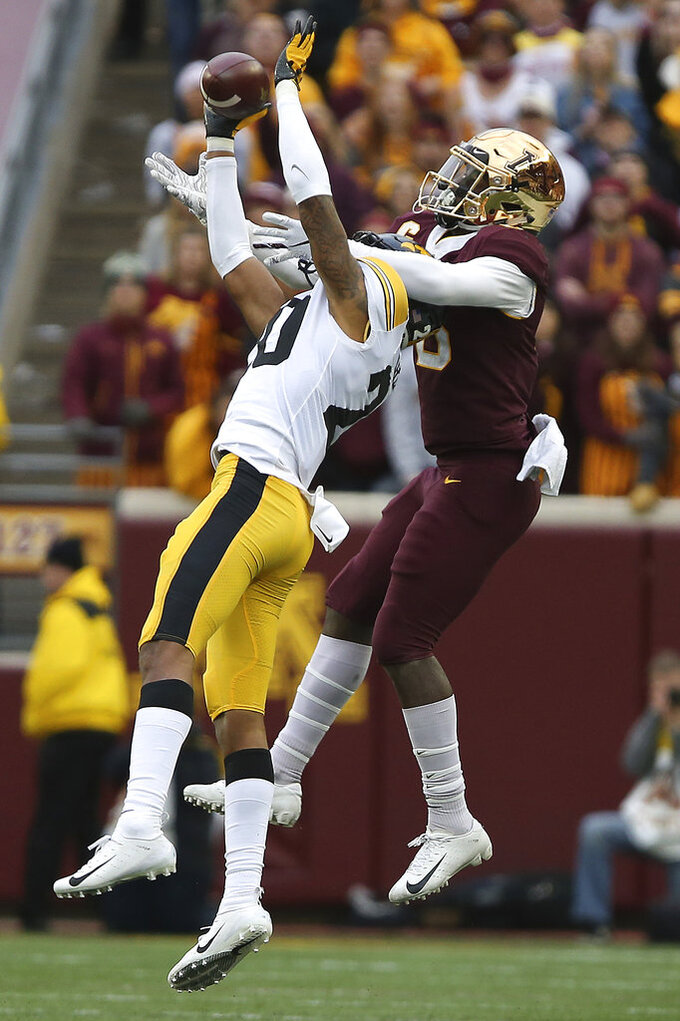 Iowa's Julius Brents intercepts the ball intended for Minnesota wide receiver Tyler Johnson during an NCAA college football game Saturday, Oct. 6, 2018, in Minneapolis. Iowa won 48-31. (AP Photo/Stacy Bengs)