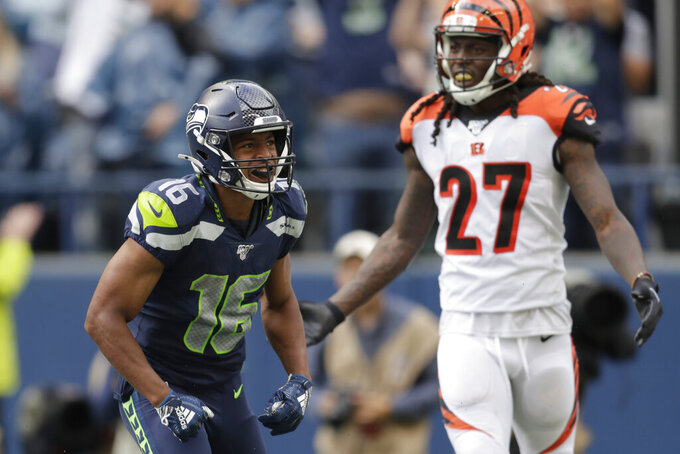 Seattle Seahawks wide receiver Tyler Lockett (16) celebrates after scoring a touchdown ahead of Cincinnati Bengals cornerback Dre Kirkpatrick (27) during the second half of an NFL football game Sunday, Sept. 8, 2019, in Seattle. (AP Photo/Stephen Brashear)