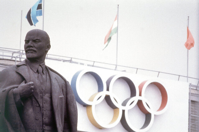 FILE - In this July 1980, a statue of Lenin sits outside of Lenin Stadium, main stadium for the 1980 Summer Olympic Games in Moscow., (AP Photo/File)