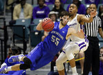 New Orleans forward Scott Plaisance Jr. (55) slips as he attempts to drive around Abilene Christian forward Jaren Lewis during the first half of an NCAA college basketball game for the Southland Conference men's tournament championship Saturday, March 16, 2019, in Katy, Texas. (AP Photo/Michael Wyke)