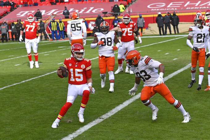 Kansas City Chiefs quarterback Patrick Mahomes (15) scores on a touchdown run during the first half of an NFL divisional round football game against the Cleveland Browns, Sunday, Jan. 17, 2021, in Kansas City. (AP Photo/Reed Hoffmann)