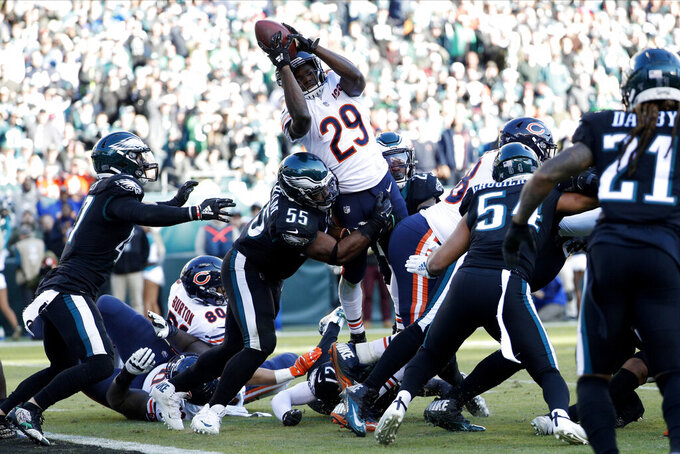 Chicago Bears' Tarik Cohen (29) cannot make it into the end zone against Philadelphia Eagles' Brandon Graham (55) during the second half of an NFL football game, Sunday, Nov. 3, 2019, in Philadelphia. (AP Photo/Chris Szagola)