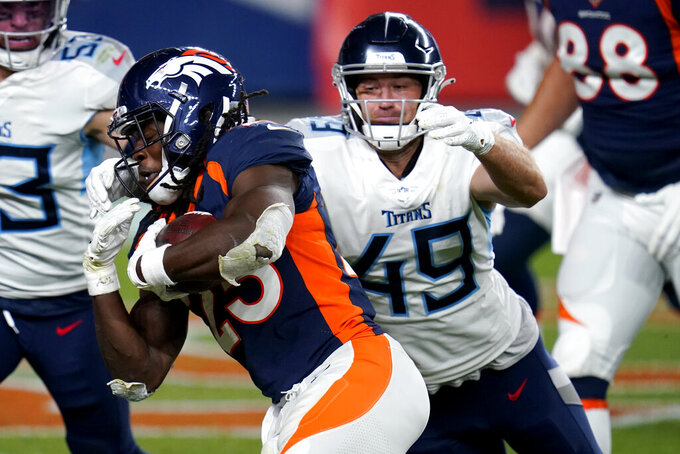 Denver Broncos running back Royce Freeman runs the ball as Tennessee Titans linebacker Nick Dzubnar (49) pursues during the second half of an NFL football game, Monday, Sept. 14, 2020, in Denver. (AP Photo/Jack Dempsey)