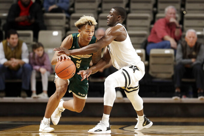 Vanderbilt guard Maxwell Evans, right, defends against Southeastern Louisiana guard Isiah Kirby, left, in the first half of an NCAA college basketball game Monday, Nov. 25, 2019, in Nashville, Tenn. (AP Photo/Mark Humphrey)