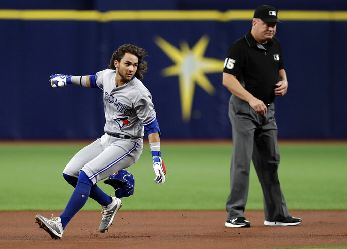 Toronto Blue Jays' Bo Bichette loses his helmet overunning second base after hitting a double off Tampa Bay Rays starting pitcher Charlie Morton during the first inning of a baseball game Monday, Aug. 5, 2019, in St. Petersburg, Fla. (AP Photo/Chris O'Meara)