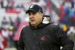 FILE - In this Oct. 19, 2019, file photo, Washington State head coach Mike Leach walks onto the field before an NCAA college football game against Colorado, in Pullman, Wash. Two people with knowledge of the decision says Mississippi State has hired Washington State's Mike Leach as its new head coach.  The people spoke to The Associated Press on condition of anonymity Thursday, Jan. 9, 2020, because the school has not yet officially announced the move. Leach will replace Joe Moorhead, who was fired last week after two seasons. (AP Photo/Young Kwak, File)