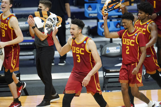 USC forward Isaiah Mobley (3) celebrates beating Kansas 85-51 after a men's college basketball game in the second round of the NCAA tournament at Hinkle Fieldhouse in Indianapolis, Monday, March 22, 2021. (AP Photo/Paul Sancya)