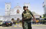 FILE - In this April 21, 2019 file photo, Sri Lankan Army soldiers secure the area around St. Anthony's Shrine after a blast in Colombo, Sri Lanka. Sri Lankans will be voting Saturday for a new president after weeks of campaigning that largely focused on national security and religious extremism in the backdrop of the deadly Islamic State-inspired suicide bomb attacks on Easter Sunday. (AP Photo/Eranga Jayawardena, File)