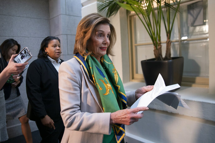 Speaker of the House Nancy Pelosi, D-Calif., arrives to meet with the Democratic Caucus at the Capitol in Washington, Tuesday, Jan. 14, 2020. Pelosi, who has not yet relayed the articles of impeachment to the Senate for the trial of President Donald Trump, has said she will discuss her next steps in that delayed process during her meeting today with fellow Democrats. Trump was impeached by the Democratic-led House last month on charges of abuse of power over pushing Ukraine to investigate Democratic rival Joe Biden and obstruction of Congress in the probe. (AP Photo/J. Scott Applewhite)