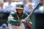 Oakland Athletics' Jurickson Profar reacts after getting hit by a pitch thrown by Kansas City Royals starting pitcher Glenn Sparkman during the first inning of a baseball game Thursday, Aug. 29, 2019, in Kansas City, Mo. (AP Photo/Charlie Riedel)