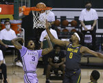 Kansas State guard DaJuan Gordon (3) scores past Baylor forward Flo Thamba (0) in the first half of an NCAA college basketball game, Wednesday, Jan. 27, 2021, in Waco, Texas. (AP Photo/Jerry Larson)
