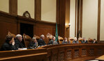 FILE - In this Jan. 22, 2019 file photo, justices on the Washington Supreme Court listen to testimony in Olympia, Wash. On Wednesday, Nov. 6, 2019, Justice Debra Stephens, third from right, was elected by her fellow members of the court to be the new chief justice to replace of the state Supreme Court to be the new chief justice to replace current Chief Justice Mary Fairhurst, center, who announced last month she will retire from the high court in January to focus on her health. (AP Photo/Ted S. Warren, File)