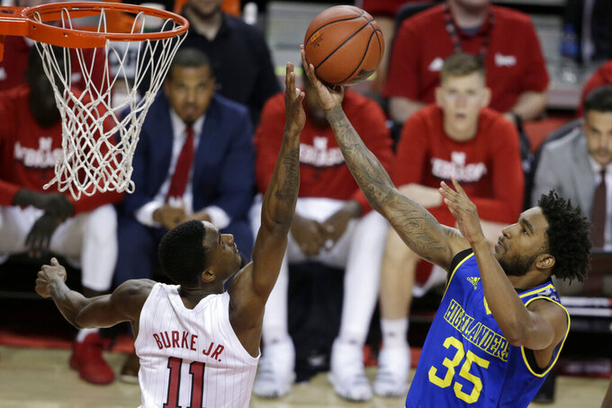 UC Riverside's George Willborn III (35) goes for a layup against Nebraska's Dachon Burke Jr. (11) during the first half of an NCAA college basketball game in Lincoln, Neb., Tuesday, Nov. 5, 2019. (AP Photo/Nati Harnik)
