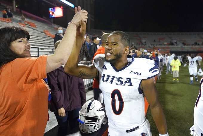 FILE - UTSA quarterback Frank Harris celebrates his team's win over Illinois in an NCAA college football game  in Champaign, Ill., in this Saturday, Sept. 4, 2021, file photo. No. 24 UTSA is nationally ranked for the first time as well as 7-0 for the first time and on its first winning streak as long as seven games as the Roadrunners visit Louisiana Tech. (AP Photo/Charles Rex Arbogast, File)