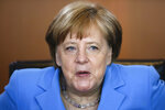 German Chancellor Angela Merkel arrives for the weekly cabinet meeting of the German government at the chancellery in Berlin, Wednesday, June 13, 2018. (AP Photo/Markus Schreiber)