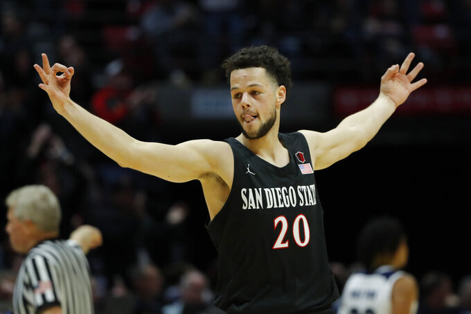 San Diego State guard Jordan Schakel reacts after making a 3-point shot during the first half of an NCAA college basketball game against Nevada, Wednesday, Feb. 20, 2019, in San Diego. (AP Photo/Gregory Bull)