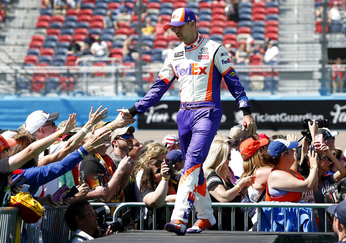 Denny Hamlin is greeted by fans during driver introductions prior to the start of the NASCAR Cup Series auto race at ISM Raceway, Sunday, March 10, 2019, in Avondale, Ariz. (AP Photo/Ralph Freso)
