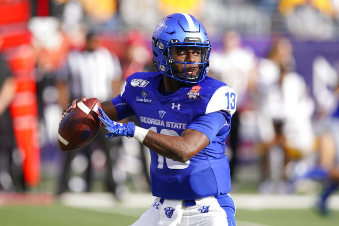 FILE - In this Dec. 31, 2019, file photo, Georgia State quarterback Dan Ellington (13) is shown in the first half during the Arizona Bowl college football game against Wyoming in Tucson, Ariz. Former Georgia State quarterback Dan Ellington, the team's starter the last two years, is joining coach Shawn Elliott's staff as an assistant coach.  (AP Photo/Rick Scuteri, File)
