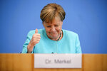 German Chancellor Angela Merkel, getures as she holds her annual summer news conference in Berlin, Germany, Thursday, July 22, 2021. (Hannibal Hanschke/Pool Photo via AP)