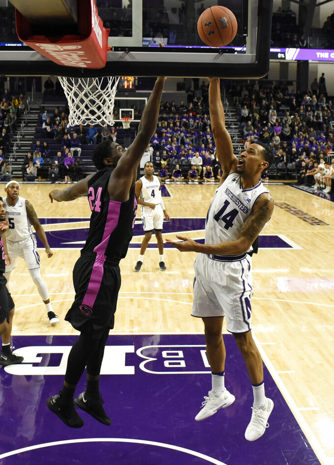 Northwestern guard Ryan Taylor (14) shoots over Penn State forward Mike Watkins (24) during the first half of an NCAA college basketball game Monday, Feb. 4, 2019, in Evanston, Ill. (AP Photo/David Banks)