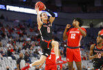 Texas Tech guard Mac McClung (0) drives inside as Houston guard Tramon Mark (12) defends during the first half of an NCAA college basketball game, Sunday, Nov. 29, 2020, in Fort Worth, Texas. (AP Photo/Ron Jenkins)