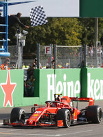 Ferrari driver Charles Leclerc of Monaco crosses the finish line to win the Formula One Italy Grand Prix at the Monza racetrack, in Monza, Italy, Sunday, Sept.8, 2019. (AP Photo/Antonio Calanni)