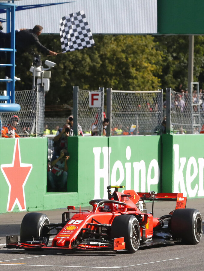 Ferrari driver Charles Leclerc of Monaco crosses the finish line to win the Formula One Italy Grand Prix at the Monza racetrack, in Monza, Italy, Sunday, Sept.8, 2019. (AP Photo/Antonio Calanni)