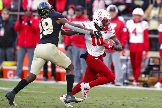 FILE - In this Nov. 2, 2019, file photo, Nebraska wide receiver JD Spielman (10) holds off Purdue cornerback Simeon Smiley (29) during the second half of an NCAA college football game in West Lafayette, Ind. Spielman, a rising senior from Eden Prairie, Minnesota, who led the Cornhuskers with 49 catches for 898 yards and five touchdowns last season, has returned home to deal with a health matter and probably will miss spring practice. Coach Scott Frost didn't address the nature of Spielman's health issue. (AP Photo/Michael Conroy, File)