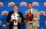 Washington State head coach Mike Leach, left, and Iowa State head coach Matt Campbell, right, pose for a photo following a news conference, Thursday, Dec. 27, 2018, in San Antonio. Washington State and Iowa State are set to play in Friday's NCAA college football Alamo Bowl. (AP Photo/Eric Gay)