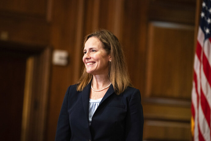 Judge Amy Coney Barrett, President Donald Trumps nominee for the U.S. Supreme Court, meets with Sen. David Perdue, R-Ga., not pictured, on Capitol Hill in Washington, Wednesday, Sept. 30, 2020. (Anna Moneymaker/The New York Times via AP, Pool)