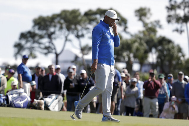 Brooks Koepka reacts after missing a putt on the eighth hole during the first round of the Honda Classic golf tournament, Thursday, Feb. 27, 2020, in Palm Beach Gardens, Fla. (AP Photo/Lynne Sladky)