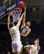 Wake Forest's Olivier Sarr (30) goes up for a shot over Notre Dame's John Mooney (33) during the second half of an NCAA college basketball game Wednesday, Jan. 29, 2020, in South Bend, Ind. Notre Dame won 90-80. (AP Photo/Robert Franklin)