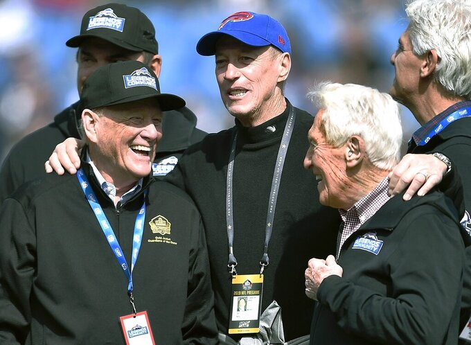 Former Buffalo Bills general manager Bill Polian, left, former quarterback Jim Kelly, center, and former head coach Marv Levy stand on the field together before an NFL football game between the Bills and the New England Patriots, Sunday, Sept. 29, 2019, in Orchard Park, N.Y. (AP Photo/Adrian Kraus)