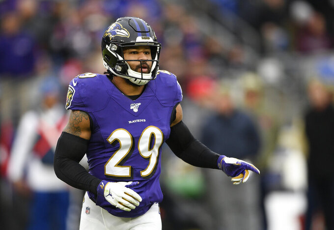FILE - In this Nov. 17, 2019, file photo, Baltimore Ravens free safety Earl Thomas waits for a play during the second half of the team's NFL football game against the Houston Texans in Baltimore. The Baltimore Ravens have terminated the contract of the seven-time Pro Bowl safety, who got involved in a fight with a teammate Friday, Aug. 21, 2020, and did not attend practice Saturday, Aug. 22. (AP Photo/Nick Wass, File)