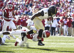 Vanderbilt running back Ke'Shawn Vaughn slips past Arkansas defender Kamren Curl to score a touchdown in the second half of an NCAA college football game Saturday, Oct. 27, 2018, in Fayetteville, Ark. (AP Photo/Michael Woods)